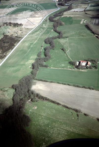 Mölleån downstream towards Vitemölla fishing village - with plantations, buildings and prehistoric remains (2 April, 1989). | LH.0408