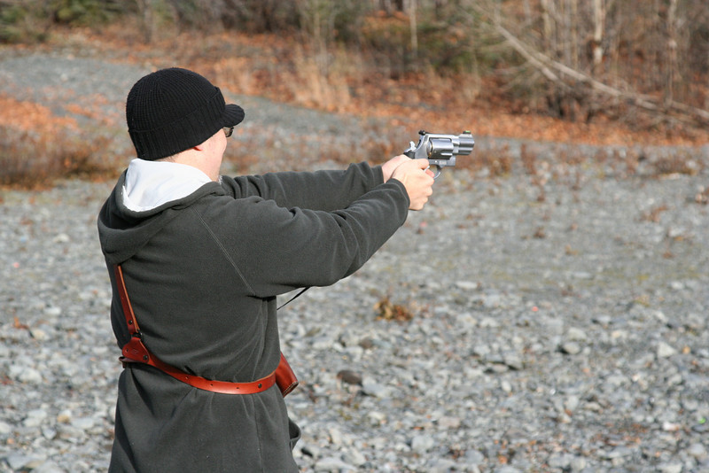 Bob practicing with a hand cannon.