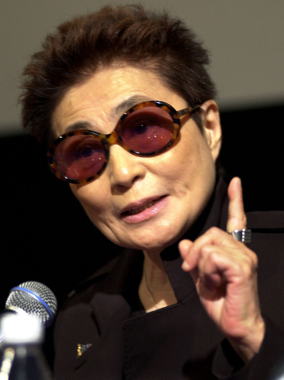 """. Artist Yoko Ono addresses members of the media during a news conference on the campus of the Massachusetts Institute of Technology, in Cambridge, Mass., Friday, Oct. 19, 2001, held as part of an introduction to Ono\'s first American retrospective exhibit. The show, called \""""YES YOKO ONO,\"""" at MIT features about 150 works, including film, video, poetry, and music, from the 1960s to the present. (AP Photo/Steven Senne)"""