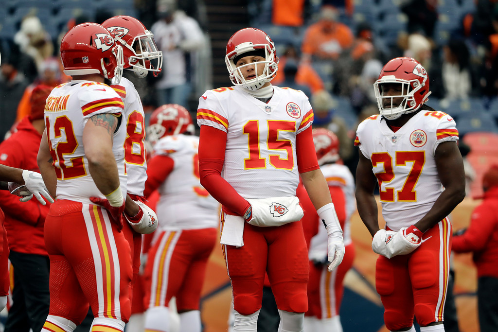 . Kansas City Chiefs quarterback Patrick Mahomes warms up with teammates before an NFL football game against the Denver Broncos Sunday, Dec. 31, 2017, in Denver. (AP Photo/Joe Mahoney)