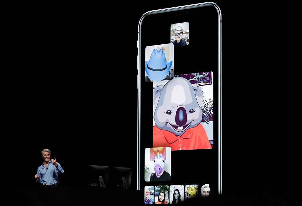 . Craig Federighi, Apple\'s senior vice president of Software Engineering, speaks about using group FaceTime with animojis during an announcement of new products at the Apple Worldwide Developers Conference Monday, June 4, 2018, in San Jose, Calif. (AP Photo/Marcio Jose Sanchez)