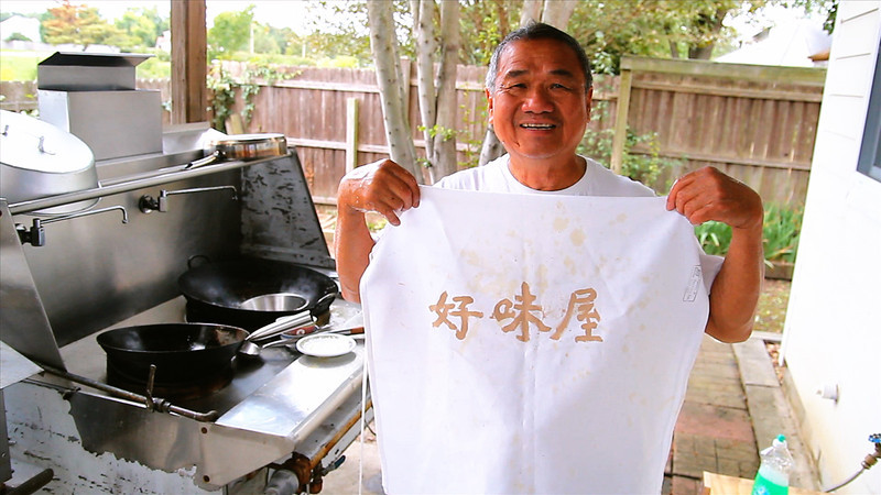 09/14/2012 - Dad showing off his apron. He translates it as, yummy yummy house.