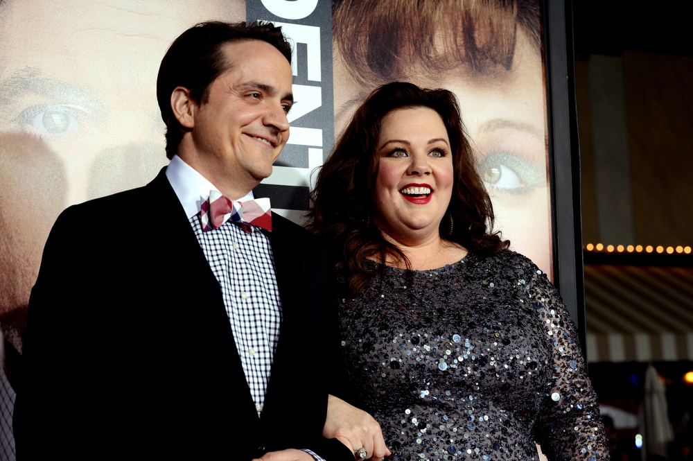 ". Actress Melissa McCarthy (R) and her husband Ben Falcone arrive at the premiere of Universal Pictures\' ""Identity Theft\"" at the Village Theatre on February 4, 2013 in Los Angeles, California.  (Photo by Kevin Winter/Getty Images)"