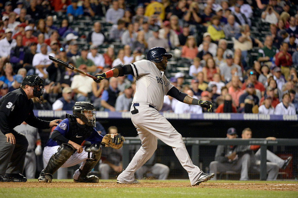 . DENVER, CO. - SEPTEMBER 24: David Ortiz (34) of the Boston Red Sox breaks his bat on a Tyler Chatwood (32) of the Colorado Rockies pitch during the 4th inning September 24, 2013 at Coors Field. (Photo by John Leyba/The Denver Post)