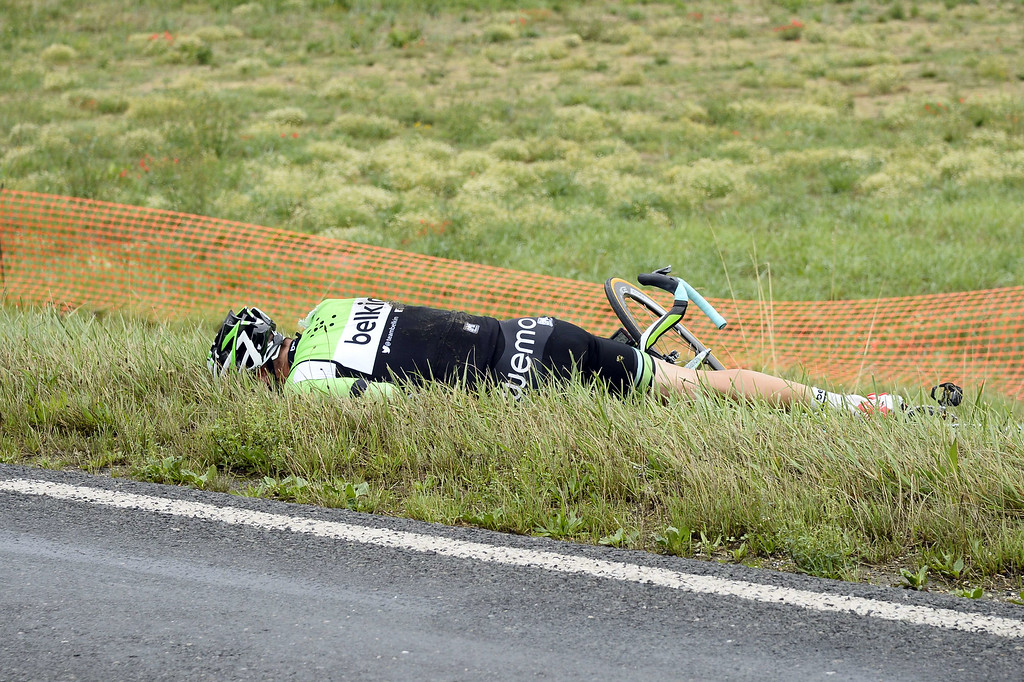 . Netherland\'s Stef Clement lies after a fall during the 234.5 km seventh stage of the 101st edition of the Tour de France cycling race on July 11, 2014 between Epernay and Nancy, northeastern France.  AFP PHOTO / LIONEL  BONAVENTURE/AFP/Getty Images