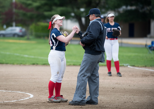 05/6/19 Wesley Bunnell | Staff St. Paul Catholic softball vs Torrington on Senior Day on Monday afternoon. Senior Abby Poirot (44) is congratulated by the umpire on senior day just prior to the start of the game.