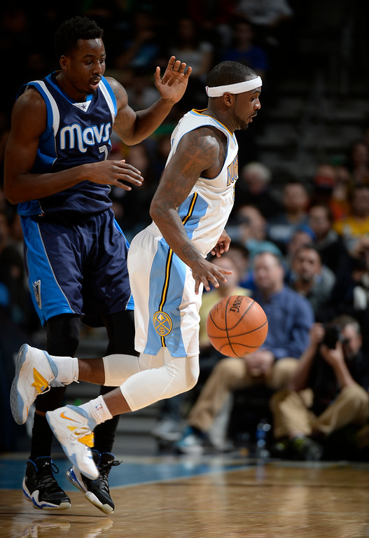 . DENVER, CO - JANUARY 14: Denver Nuggets guard Ty Lawson (3) avoids running into Dallas Mavericks forward Al-Farouq Aminu (7) during the fourth quarter  January 14, 2015 at Pepsi Center. (Photo By John Leyba/The Denver Post)