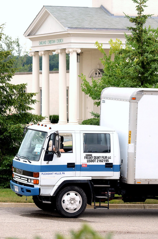 """. A production truck sits outside of Oakland Christan Church in Oakland Township.  Scenes for a movie named \""""Freaky Deaky\"""" being shot at the churc.  The movie is from a Elmore Leonard book, starring Christian Slater, Billy Burke and Crispin Glover.  The Oakland Press/TIM THOMPSON"""