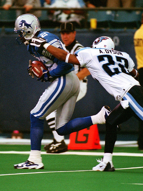 . Detroit Lions wide receiver  Germane Crowell (left)  gets past Tennessee Titan cornerback Andre Dyson to score a touchdown in the Lions 27-24 loss at the Pontiac Silverdome Sunday.  Crowell later injured his knee tendon and likely will be out the season.