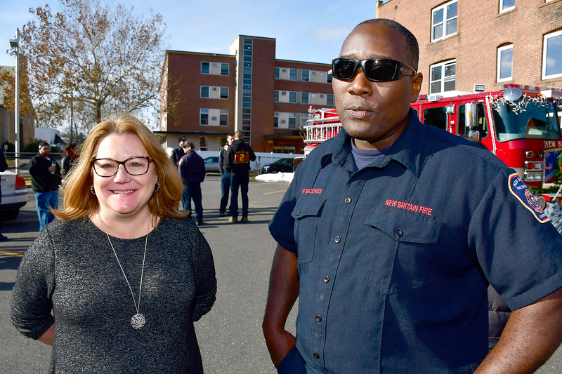 12/1/2018 Mike Orazzi | Staff Exalted Ruler Debra Scarlett and firefighter Tracey Bacchus during a fill a fire truck event at the New Britain Elks Lodge No. 957 with help from the New Britain Fire Department Saturday morning in New Britain. Items collected are to benefit the disabled veterans of New Britain and Newington.