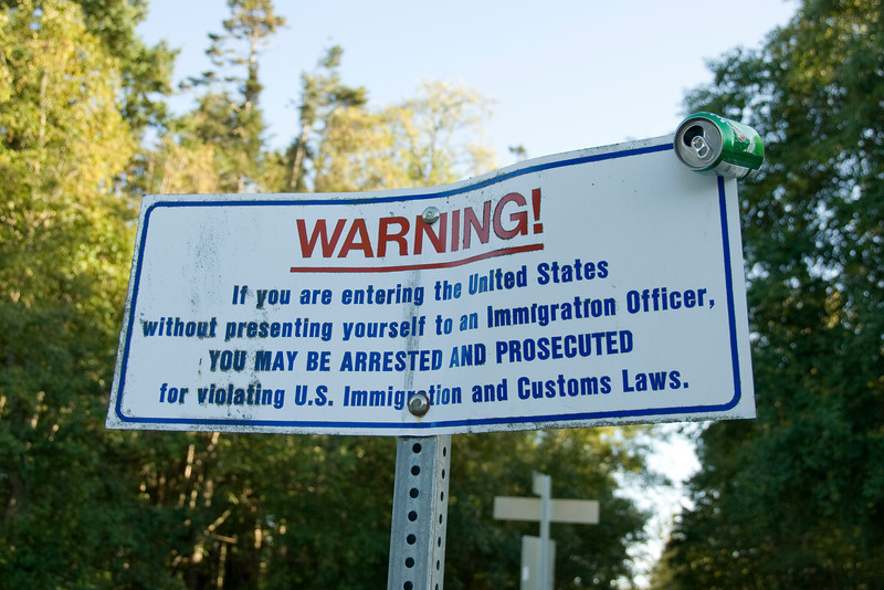 Notice at the international boundary between Canada and the United States in Point Roberts, Washington
