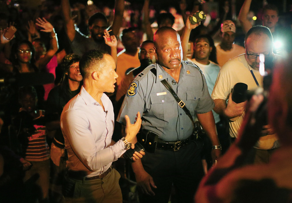 . FERGUSON, MO - AUGUST 14:  Capt. Ronald Johnson of the Missouri State Highway Patrol, who was appointed by the governor to take control of security operations in the city of Ferguson, walks among demonstrators gathered along West Florissant Avenue on August 14, 2014 in Ferguson, Missouri. Violent protests have erupted along West Florissant in Ferguson each of the last four nights as demonstrators express outrage over the shooting death of Michael Brown by a Ferguson police officer on August 9.The governor appointed Johnson after receiving numerous complaints about the excessive show and use of force by the police against protestors and the news media covering the demonstrations. Senator Claire McCaskill (D-MO) today called for the demilitarization of the police.  (Photo by Scott Olson/Getty Images)