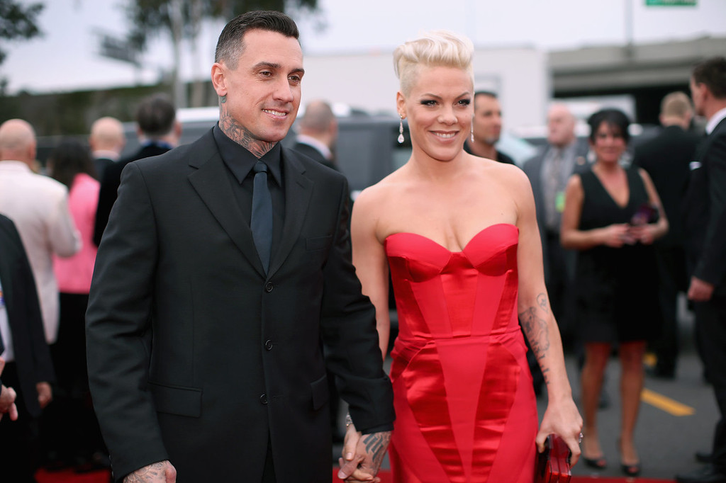 . Off-road truck racer Carey Hart and singer Pink attend the 56th GRAMMY Awards at Staples Center on January 26, 2014 in Los Angeles, California.  (Photo by Christopher Polk/Getty Images for NARAS)