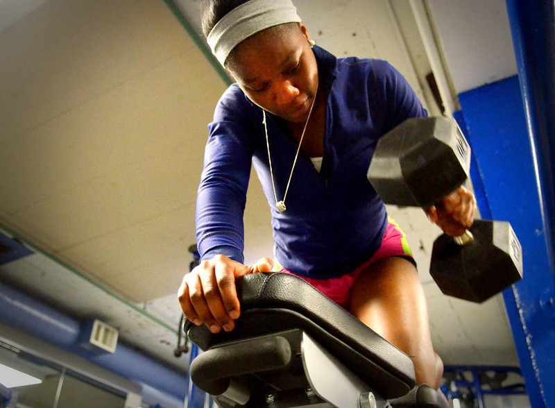 """. Shabazz works out with free weights at the Teen Center. \""""I\'m my biggest critic,\"""" said Shabazz about her competitive nature. (Pioneer Press: John Autey)"""