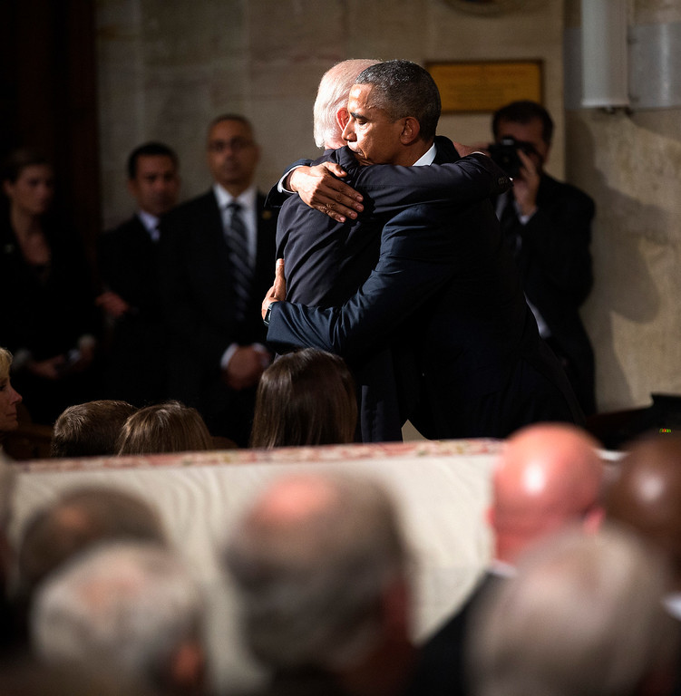 . President Obama hugs Vice President Joe Biden during the funeral services for Biden\'s son, Beau Biden, Saturday, June 6, 2015, at the St. Anthony of Padua Church in Wilmington, Del. (Doug Mills/The New York Times Times via AP, Pool)