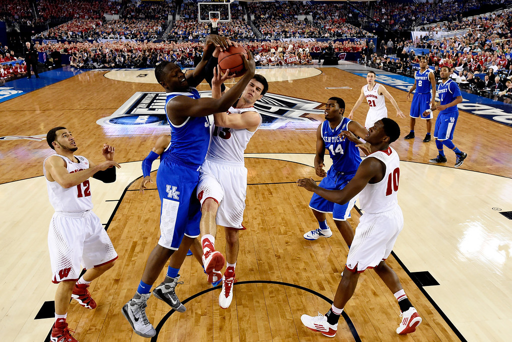 . ARLINGTON, TX - APRIL 05:  Julius Randle #30 of the Kentucky Wildcats and Duje Dukan #13 of the Wisconsin Badgers battle for a rebound during the NCAA Men\'s Final Four Semifinal at AT&T Stadium on April 5, 2014 in Arlington, Texas. (Photo by Chris Steppig-Pool/Getty Images)