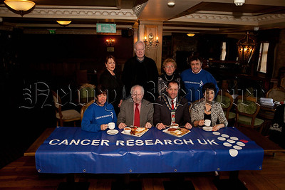 Mayor Mickey Ruane is pictured with Gervase McCartan at the launch of thuis years big breakfast in aid of Cancer Research to take plavce in Bellinis on Friday 21st March.Also pictured are Aibhin Frizell, Davy Dodds, Rae Dodds, Paddy O'Hanlon, Rosalind McCullough and Hilary Halliday. R1310009