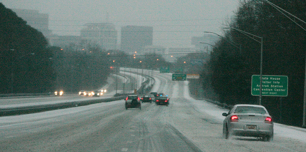 . Ice and snow cover Interstate 26, early Wednesday, Feb. 12, 2014, in Columbia, S.C. Gov. Nikki Haley again declared a state of emergency as emergency officials worried that as much as an inch of ice accumulating on trees and power lines Wednesday into Thursday could knock out powers to thousands, especially in the Midlands. (AP Photo/Mary Ann Chastain)