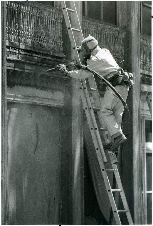 . Matt Gibson gets some sand blasting done on the south side of the Mooreland Mansion on Lakeland Community College grounds on June 10, 1992. Staining Systems of Valley View took two days to get the south side of the mansion blasted down to the original wood of the structure. (News-Herald file)