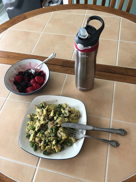 Dan Bitterlich - Veggie (onions, mushrooms, asparagus, and scallions) scramble with some mixed berries and water.