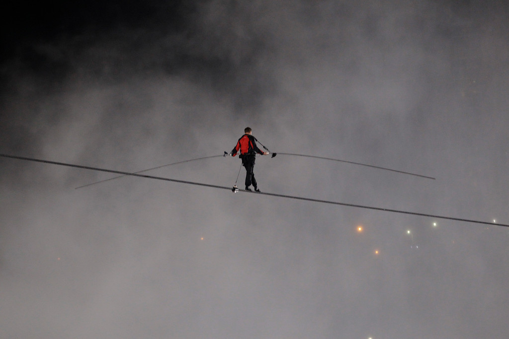 . Nik Wallenda walks across Niagara Falls on a tightrope as seen from Niagara Falls, N.Y., Friday, June 15, 2012. Wallenda has finished his attempt to become the first person to walk on a tightrope 1,800 feet across the mist-fogged brink of roaring Niagara Falls. The seventh-generation member of the famed Flying Wallendas had long dreamed of pulling off the stunt, never before attempted. (AP Photo/David Duprey)