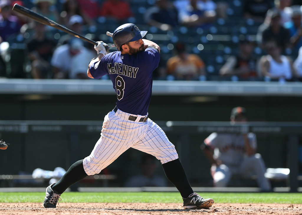 . Colorado Rockies\' Michael McKenry follows the flight of his solo home run against the San Francisco Giants to lead off the bottom of the sixth inning of the Rockies\' 9-2 victory in a baseball game in Denver, Wednesday, Sept. 3, 2014. (AP Photo/David Zalubowski)