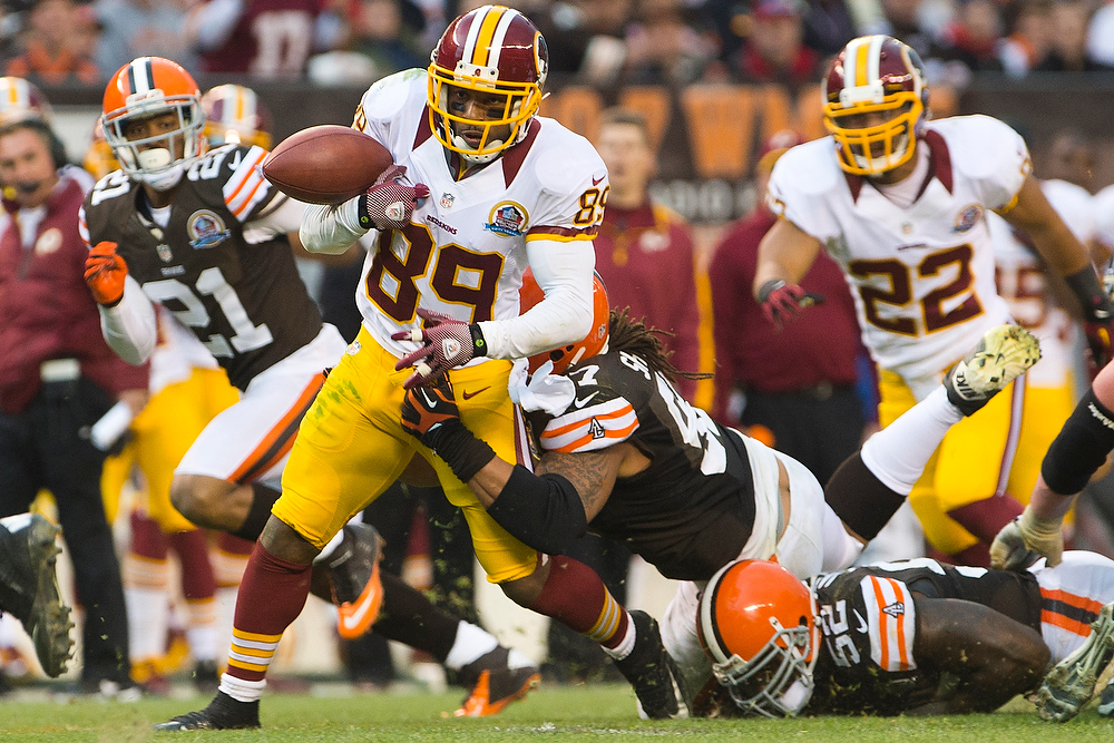 . Wide receiver Santana Moss #89 of the Washington Redskins fumbles the ball during the second half against the Cleveland Browns at Cleveland Browns Stadium on December 16, 2012 in Cleveland, Ohio. The Redskins defeated the Browns 38-21. (Photo by Jason Miller/Getty Images)