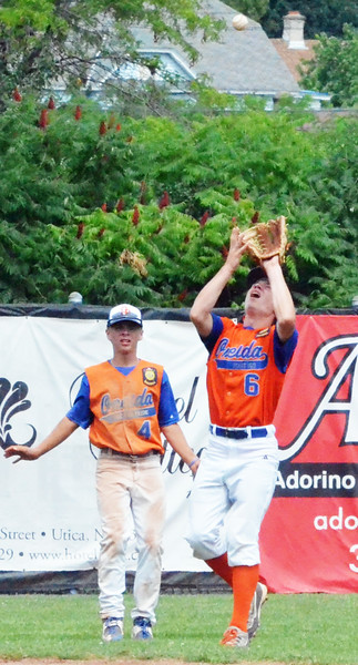 KYLE MENNIG - ONEIDA DAILY DISPATCH Oneida Post's Henry Froass (6) reaches to make a catch to retire a Vestal Post batter during the New York State Junior American Legion Baseball championship game in Utica on Saturday, July 30, 2016. Backing up the play is Oneida's Lukas Albro.