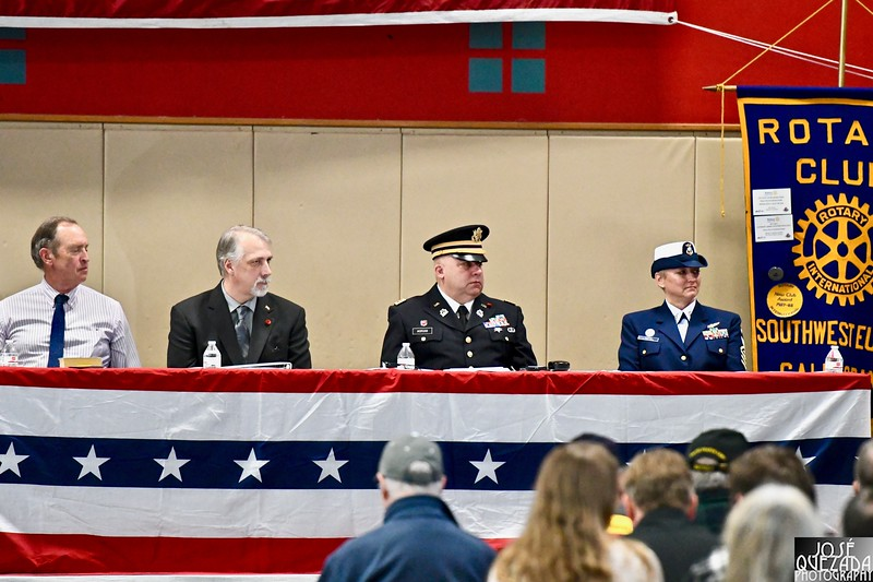 A close-up of the north wing of the Honor table at the head of the packed Adorni Center for Veterans Day.