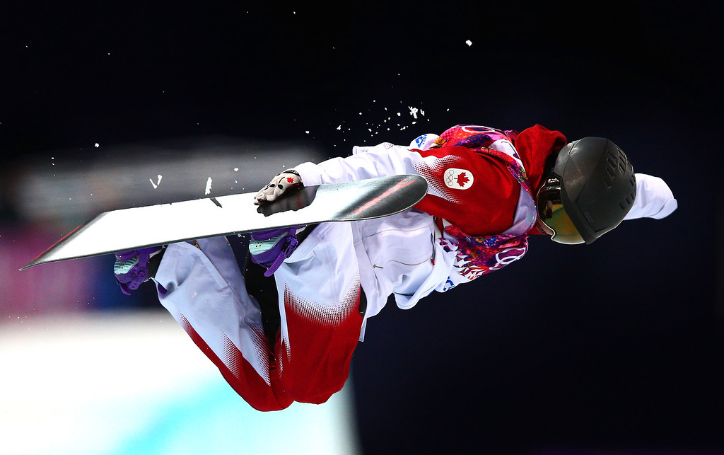 . Katie Tsuyuki of Canada competes in the Snowboard Women\'s Halfpipe Semifinals on day five of the Sochi 2014 Winter Olympics at Rosa Khutor Extreme Park on February 12, 2014 in Sochi, Russia.  (Photo by Cameron Spencer/Getty Images)