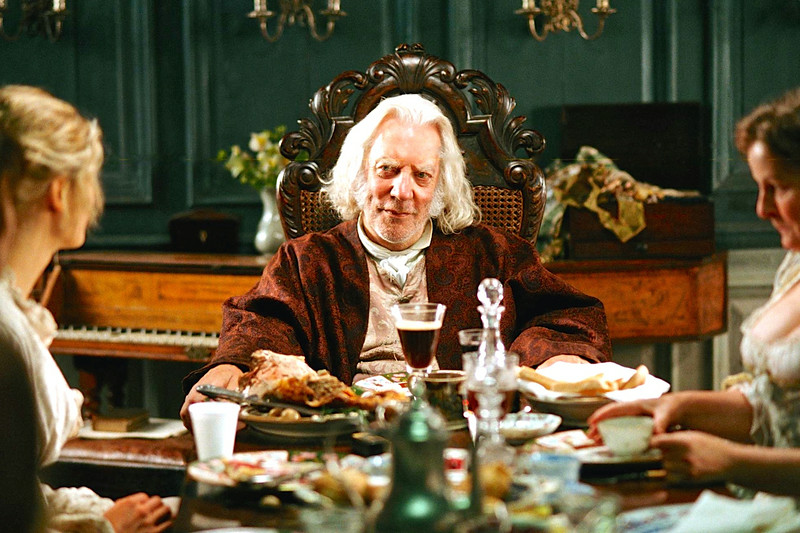 Mr. Bennet at table.jpg