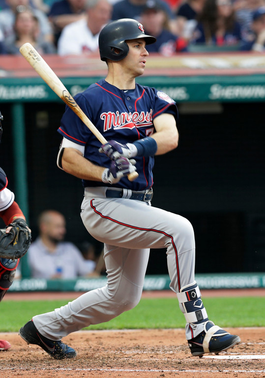 . Minnesota Twins\' Joe Mauer bats against the Cleveland Indians during the fifth inning of a baseball game Friday, June 15, 2018, in Cleveland. The Twins won 6-3. (AP Photo/Tony Dejak)