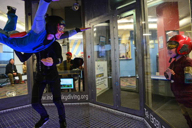 . Max Vertin, 8,  of Hastings, Nebraska, right, enjoys watching his brother Chance, 6, as he flies through the air in the wind tunnel at SkyVenture Colorado indoor sky diving with the help of instructor Josh Evans, left, in Lone Tree, Co  on April 15, 2014. Vertin has Duchenne Muscular Dystrophy, a rare disease affecting him and his two brothers causing their muscles to slowly deteriorate, Through the help of the Make A Wish foundation Vertin and his entire family flew in the wind tunnel.  And as a special treat Max\'s superhero idol Iron Man made an appearance just for him at the venue. Max was  given his very own Iron Man flight suit and ended the day by driving off in a Humvee limousine in front of supporters from local software firm Intuit.  (Photo By Helen H. Richardson/ The Denver Post)