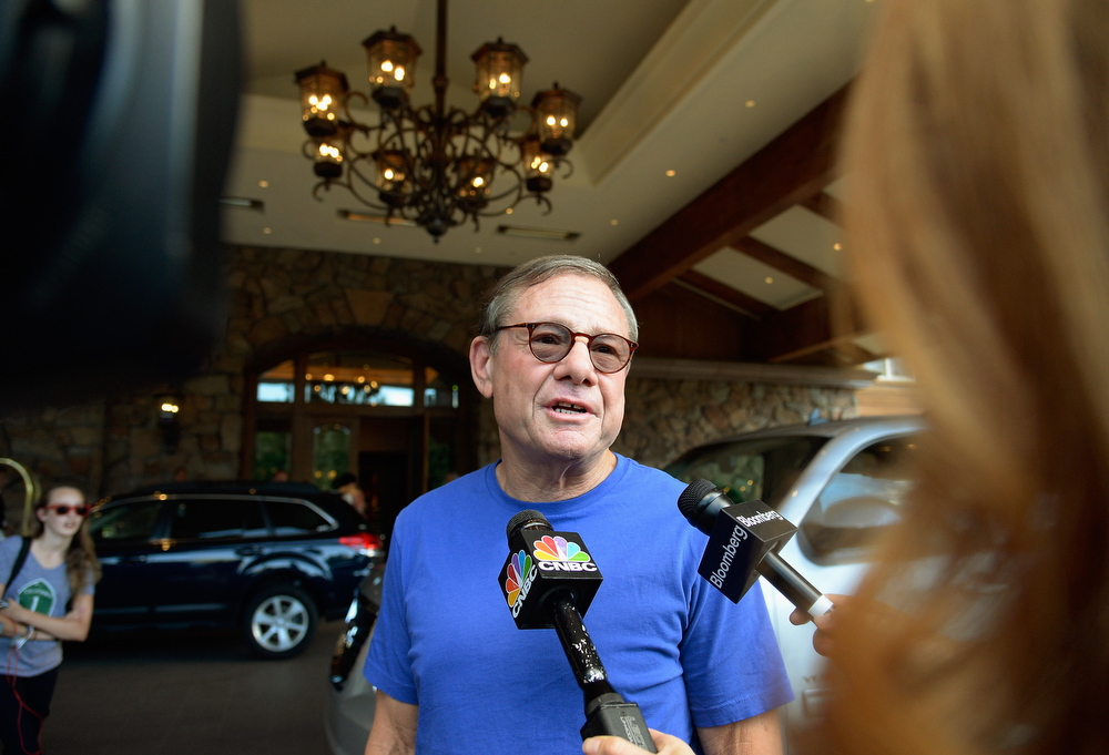 . Michael Ovitz, chief operating officer of venture capital fund Broad Beach Ventures, speaks with reporters as he arrives for the annual conference on July 9, 2013 in Sun Valley, Idaho. The resort will host corporate leaders for the 31th annual Allen & Co. media and technology conference where some of the wealthiest and most powerful executives in media, finance, politics and tech gather for a weeklong meetings which begins Tuesday. Past attendees included Warren Buffett, Bill Gates and Mark Zuckerberg.  (Photo by Kevork Djansezian/Getty Images)
