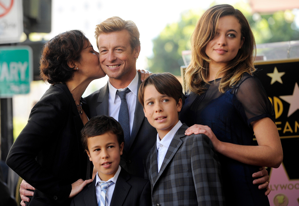 . Australian actor Simon Baker gets a kiss from his wife Rebecca, left, as they pose with their children, from left, Harry, Claude and Stella at a ceremony to award Baker a star on the Hollywood Walk of Fame, on Thursday, Feb. 14, 2013 in Los Angeles. (Photo by Chris Pizzello/Invision/AP)