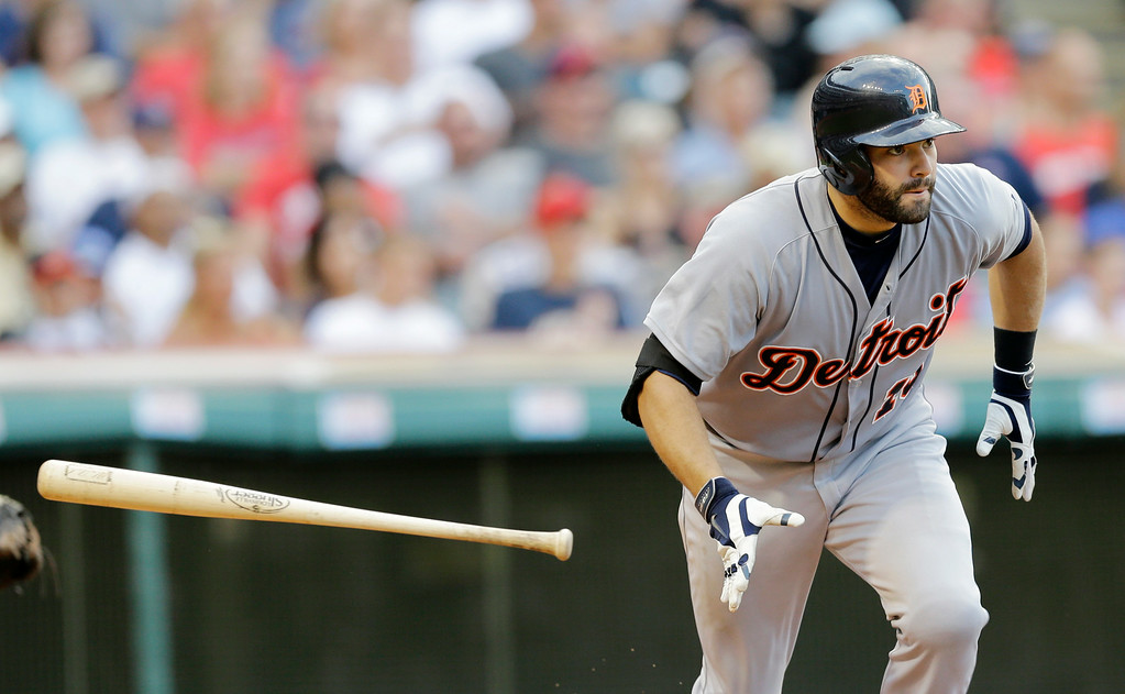 . Detroit Tigers\' Alex Avila watches his ball after hitting an RBi-single off Cleveland Indians relief pitcher Nick Hagadone in the seventh inning of a baseball game, Monday, Sept. 1, 2014, in Cleveland. Miguel Cabrera scored on the play. (AP Photo/Tony Dejak)