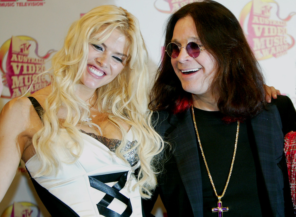 . ** FILE ** Rocker Ozzy Osbourne right, and one of America\'s most outrageous personalities and Playboy Playmate of the Year, Anna Nicole Smith, appear for the Australia MTV awards in Sydney, in this March 2, 2005, file photo.Smith, 39, the former Playboy playmate whose bizarre life careened from marrying an octogenarian billionaire to the untimely death of her son, died Thursday, Feb. 8, 2007, after collapsing at a South Florida hotel, one of her lawyers said.  (AP Photo/Rob Griffith, file)