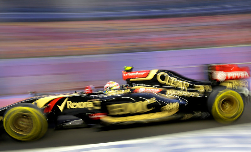 . Lotus driver Pastor Maldonado of Venezuela steers his car during the first practice session for the Singapore Formula One Grand Prix on the Marina Bay City Circuit in Singapore, Friday, Sept. 19, 2014. (AP Photo/Wong Maye-E)
