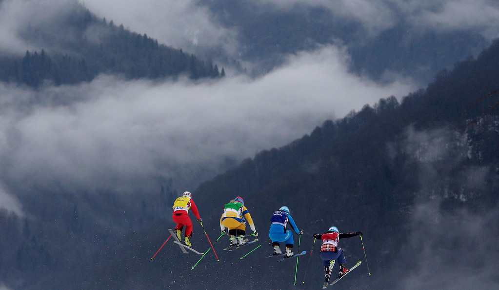 . Switzerland\'s Fanny Smith, from left, Sweden\'s Anna Holmlund, Austria\'s Katrin Ofner and Canada\'s Kelsey Serwa compete during their ski cross race at the 2014 Winter Olympics, Friday, Feb. 21, 2014, in Krasnaya Polyana, Russia. (AP Photo/Matthias Schrader, File)