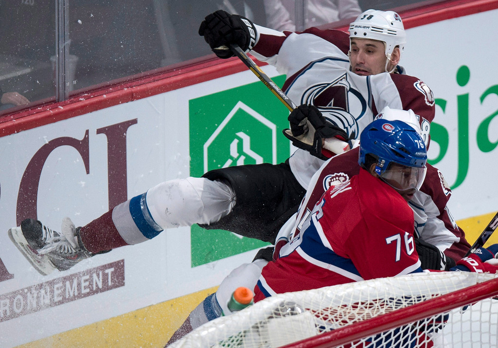 . Colorado Avalanche\'s Patrick Bordeleau is taken out by Montreal Canadiens defenseman P.K. Subban during second period NHL hockey action Tuesday, March 18, 2014 in Montreal.  (AP Photo/The Canadian Press, Paul Chiasson)
