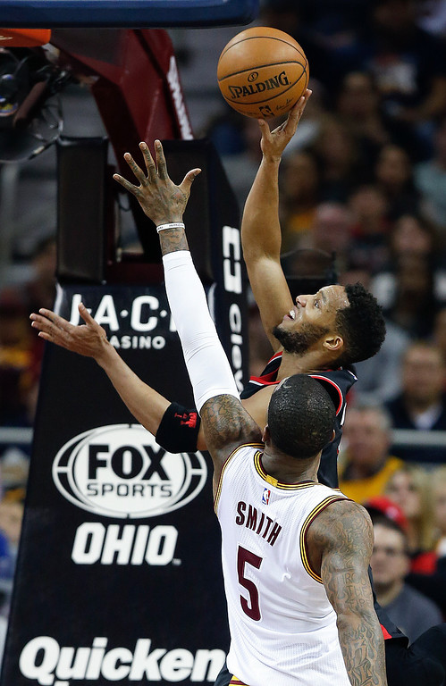 . Portland Trail Blazers\' Evan Turner (1) scores past Cleveland Cavaliers\' J.R. Smith (5) during the first half of an NBA basketball game, Wednesday, Nov. 23, 2016, in Cleveland. (AP Photo/Ron Schwane)
