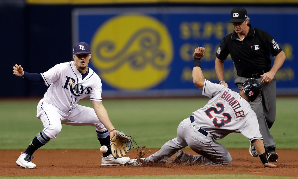 . Cleveland Indians\' Michael Brantley (23) steals second base as Tampa Bay Rays shortstop Willy Adames fields the throw during the first inning of a baseball game Monday, Sept. 10, 2018, in St. Petersburg, Fla. Making the call is umpire Paul Nauert. (AP Photo/Chris O\'Meara)