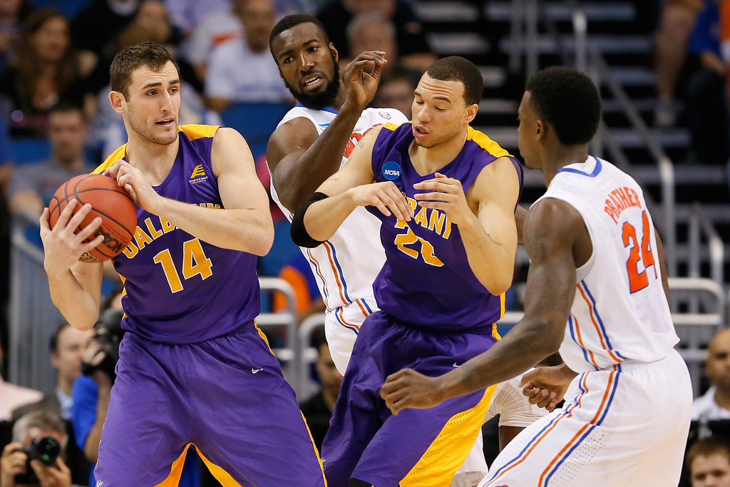. ORLANDO, FL - MARCH 20:  Sam Rowley #14 of the Albany Great Danes with the ball against Patric Young #4 of the Florida Gators in the second half during the second round of the 2014 NCAA Men\'s Basketball Tournament at Amway Center on March 20, 2014 in Orlando, Florida.  (Photo by Kevin C. Cox/Getty Images)