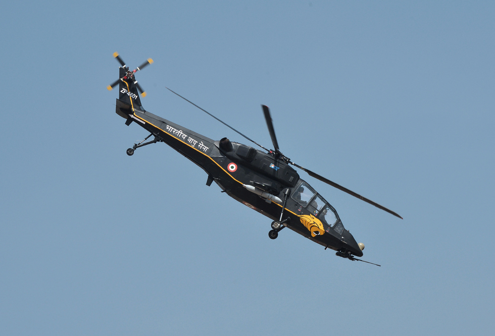 "Description of . A HAL ""Black Tiger\"" Light Combat Helicopter (LCH), currently under development for the Indian armed forces, performs during Aero India 2013 at the Yelahanka Air Force station in Bangalore on February 6, 2013. India, the world\'s leading importer of weaponry, opened one of Asia\'s biggest aviation trade shows Wednesday with Western suppliers eyeing lucrative deals and a Chinese delegation attending for the first time.  Manjunath Kiran/AFP/Getty Images"