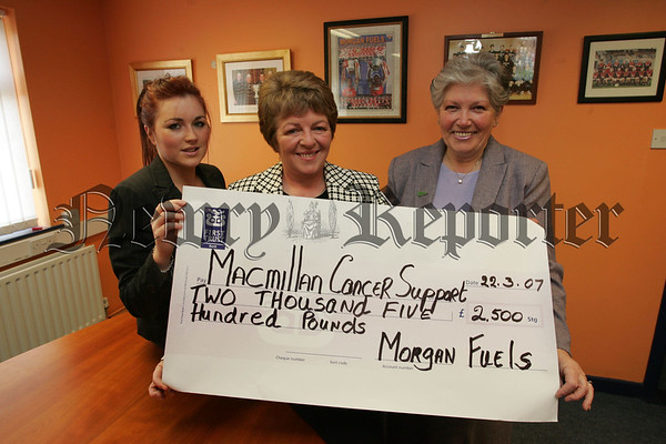 Fionnuala Mullen and Ethna Morgan from Morgan Fuels present a cheque for £2500 to Martha McGrath who Represents Macmillan Cancer Support, the money was raised in lieu of Christmas Gifts. 07W13N5