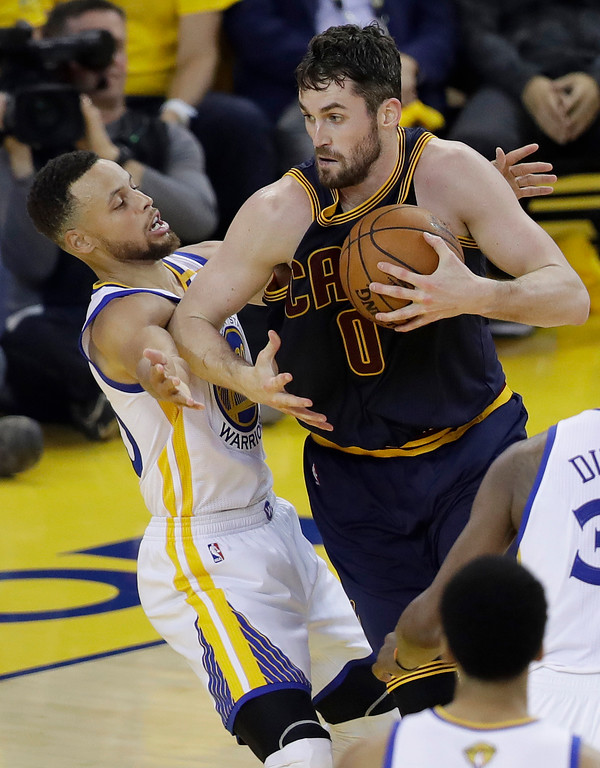 . Cleveland Cavaliers forward Kevin Love (0) is guarded by Golden State Warriors guard Stephen Curry during the first half of Game 1 of basketball\'s NBA Finals in Oakland, Calif., Thursday, June 1, 2017. (AP Photo/Marcio Jose Sanchez)