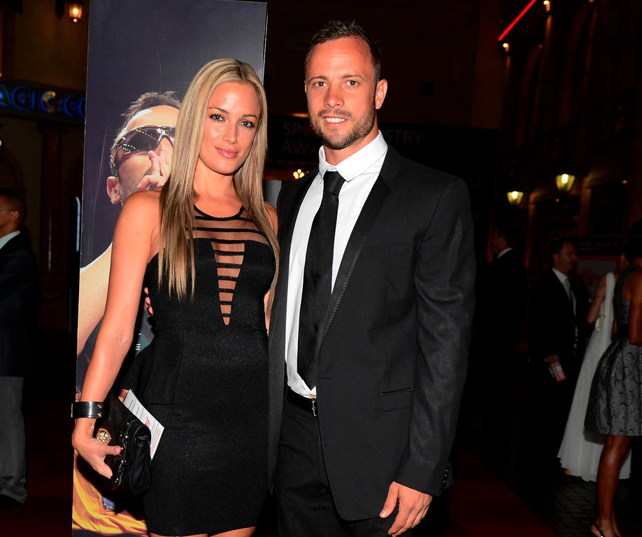 ". Oscar Pistorius (R) and his girlfriend Reeva Steenkamp pose for a picture in Johannesburg, February 7, 2013. South African ""Blade Runner\"" Oscar Pistorius, a double amputee who became one of the biggest names in world athletics, was charged on February 14, with shooting dead his girlfriend at his home in Pretoria. Picture taken February 7, 2013. REUTERS/Thembani Makhubele"