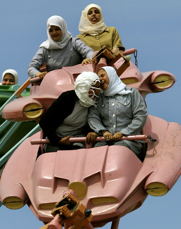 . In this Sunday, March 26, 2006  file photo made by Associated Press photographer Anja Niedringhaus, Palestinians enjoy a ride at an amusement park outside Gaza City.  (AP Photo/Anja Niedringhaus, File)