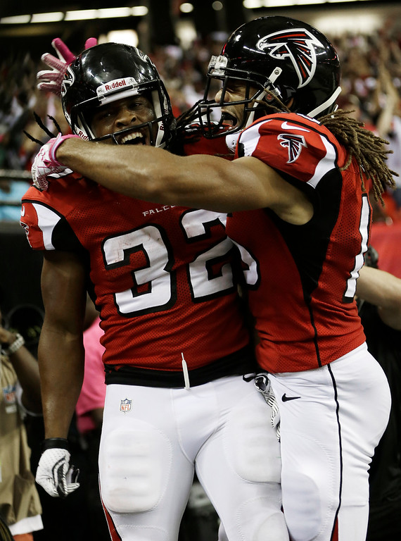 . Atlanta Falcons running back Jacquizz Rodgers (32) celebrates his touchdown with Atlanta Falcons wide receiver Kevin Cone (15) during the second half of an NFL football game against the New York Jets, Monday, Oct. 7, 2013, in Atlanta. (AP Photo/John Bazemore)