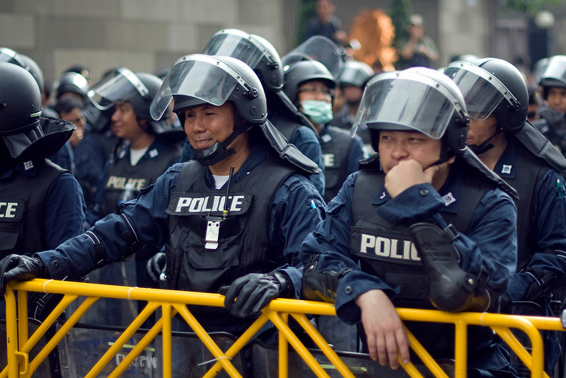 Policemen along the steel barricade at the Red Shirt Protest - Thailand